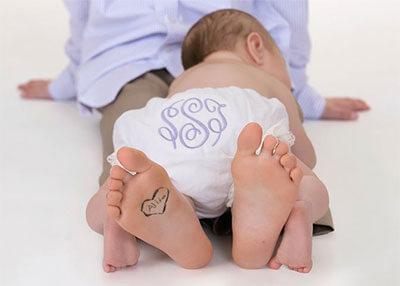 Baby in monogramed diaper